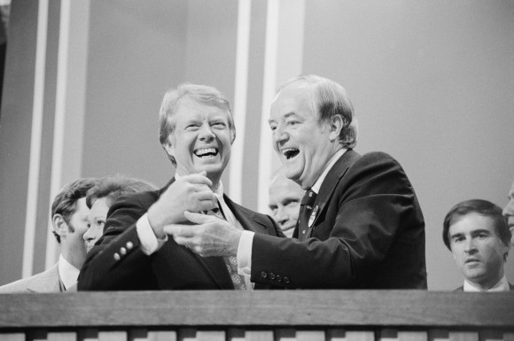 Jimmy Carter (L), a clean-shaven Gallagher (R)