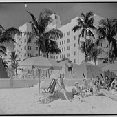 """Beachgoers enjoying what the Go-Go's refer to as a """"vacation."""" Brits like Madonna call it a """"holiday."""""""
